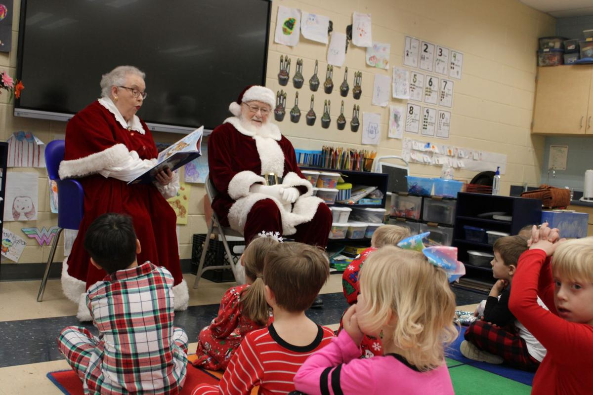 Santa and Mrs. Claus visit St. Mary's kids