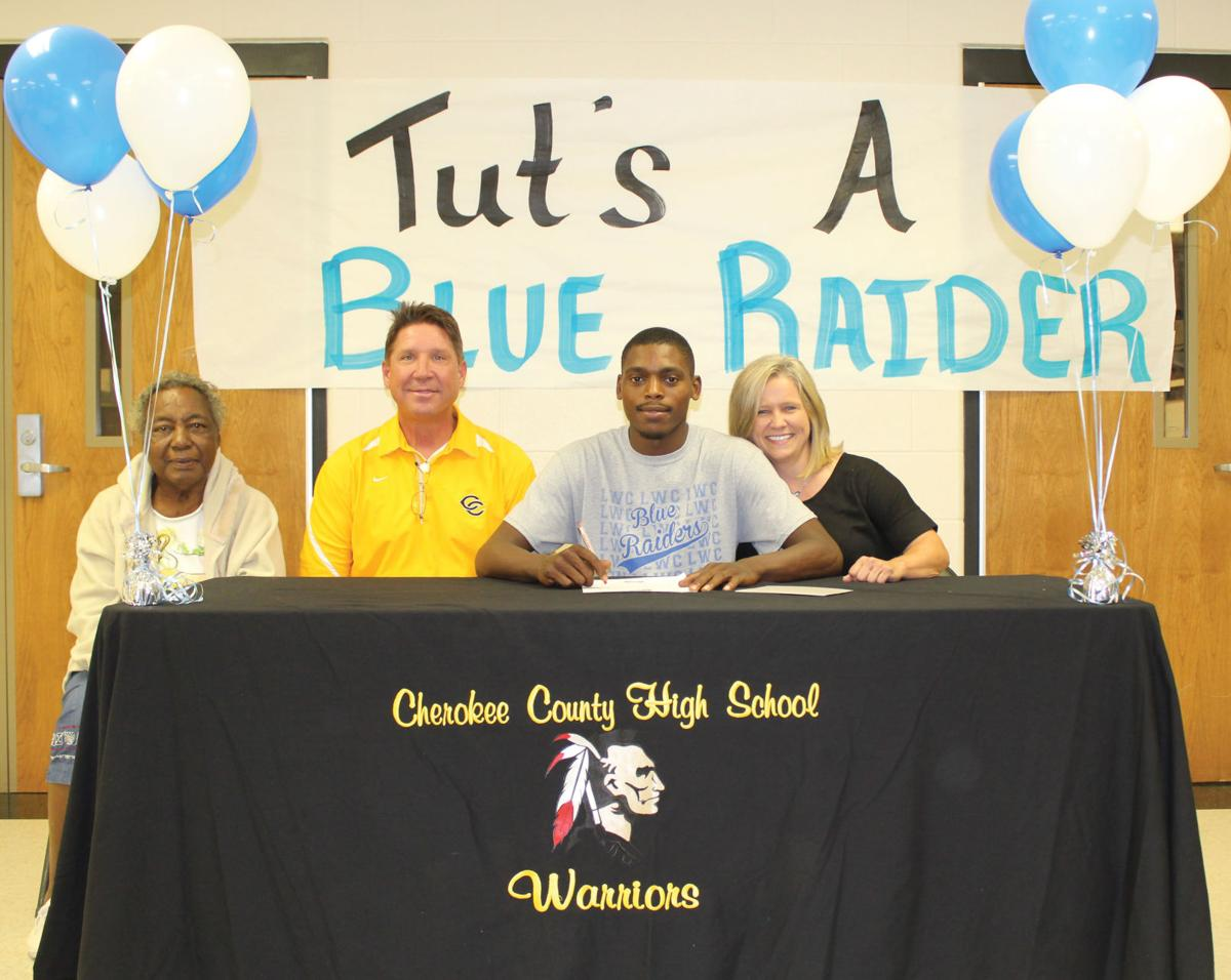 Quartez Henderson signs football scholarship with Lindsey Wilson