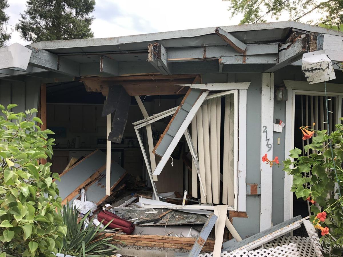 House on N.W. Troost Street damaged by car crash