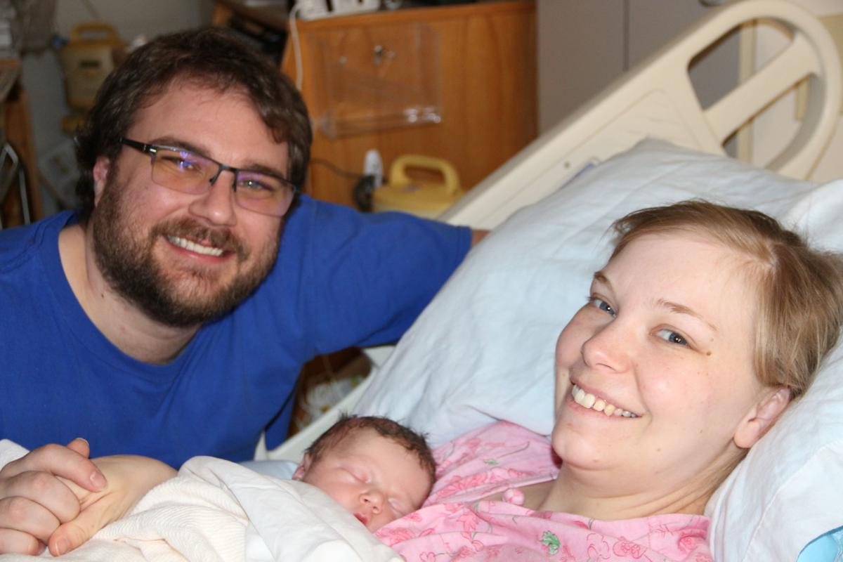 Derek and Sierra Stone and baby Izaak Alexander Stone