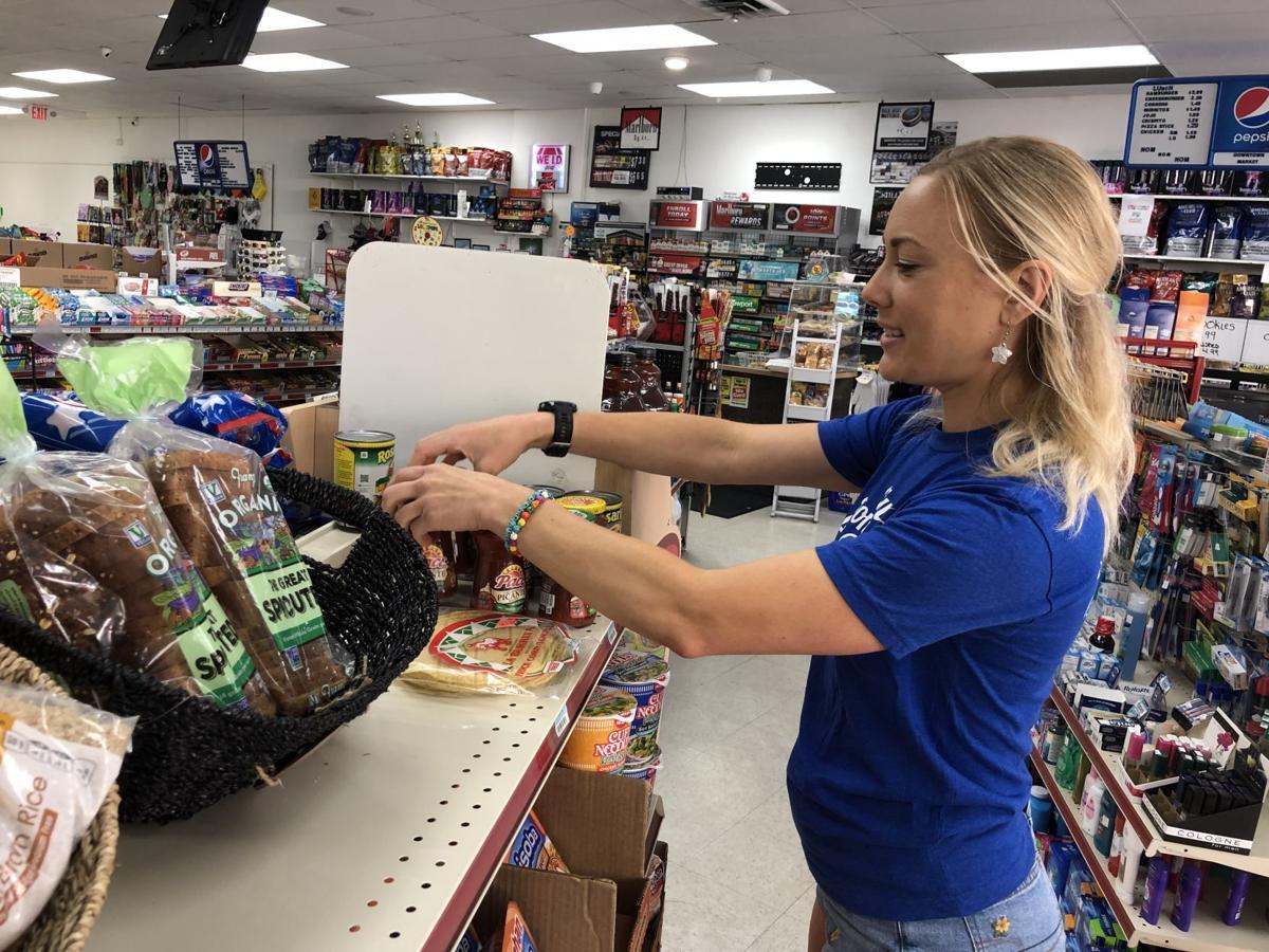 Registered dietitian Jenny Wood rearranges food in market