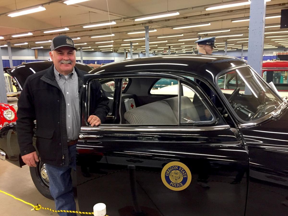 Tim McLain displays restored 1950 Oregon State Police patrol car