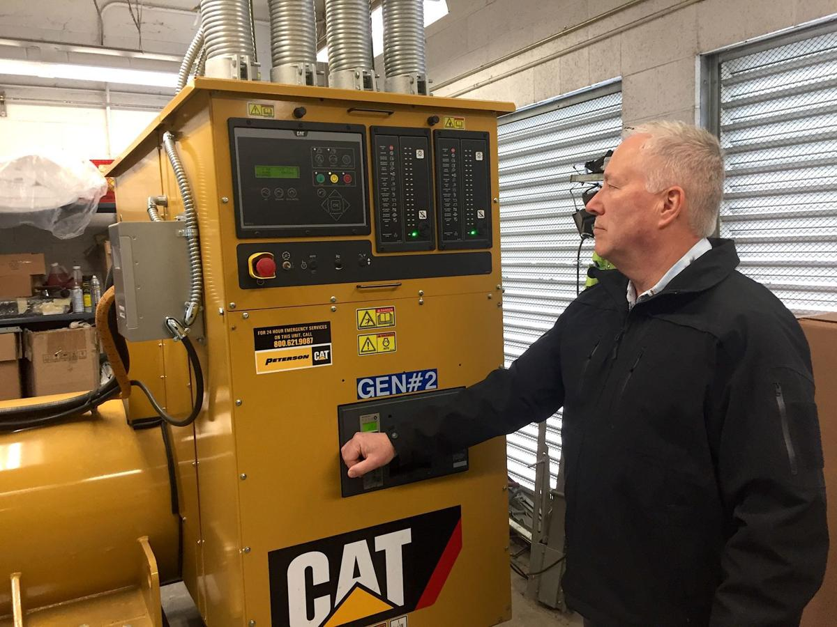 Ron Taylor with backup generator at Mercy