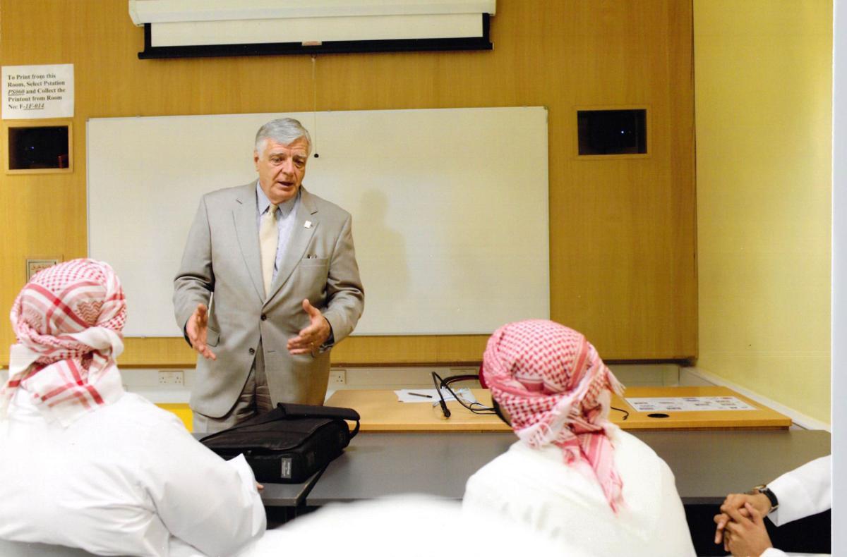 Dr. Dan Johnson lectures to Emirati men in Dubai
