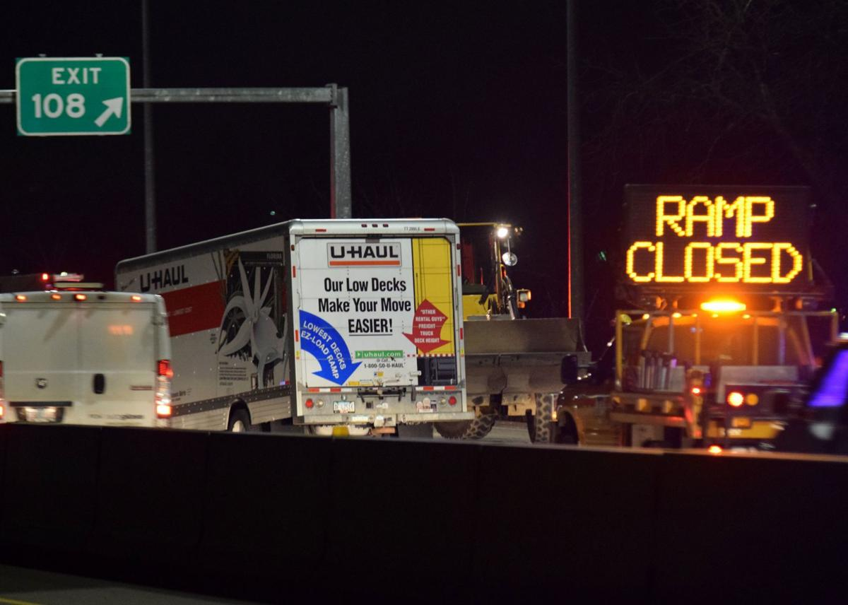 Traffic on Interstate 5 moves slowly on Thursday night as work crews clean up a severe traffic accident at the mile-marker 108 exit near Myrtle Creek.