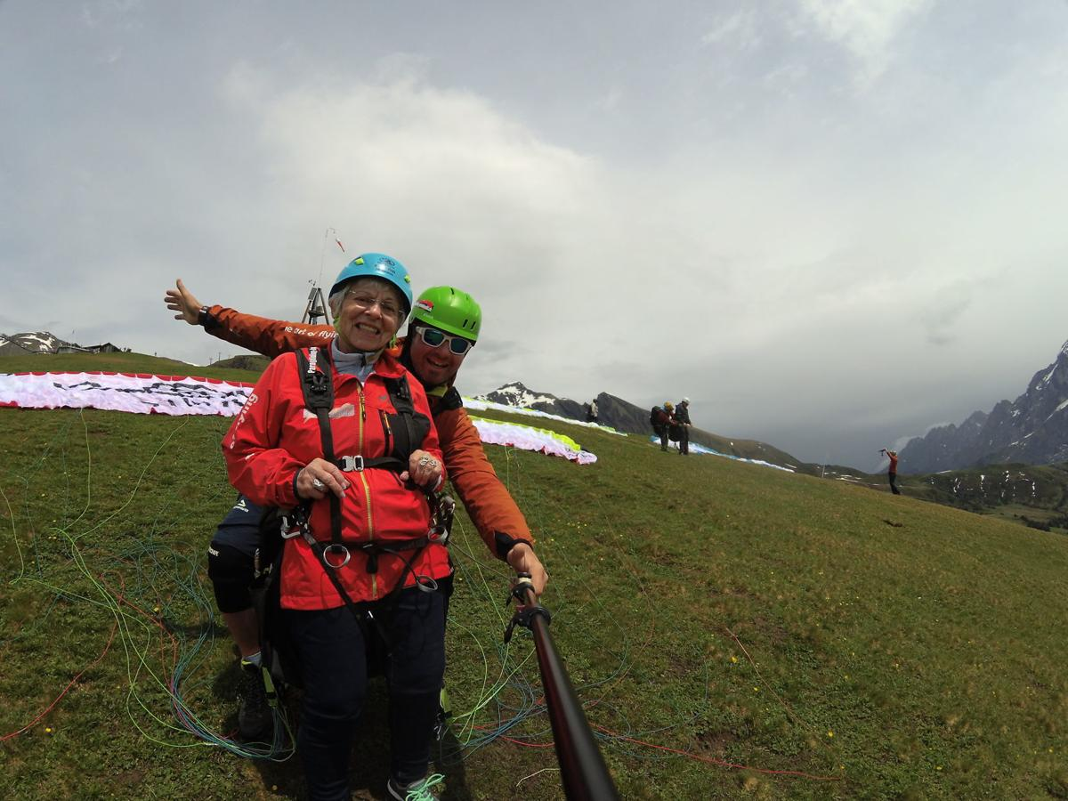 Doris Heyman gets ready for paragliding experience in the Swiss Alps