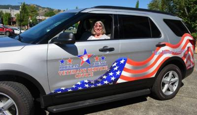 Mary Newman in veteran vehicle