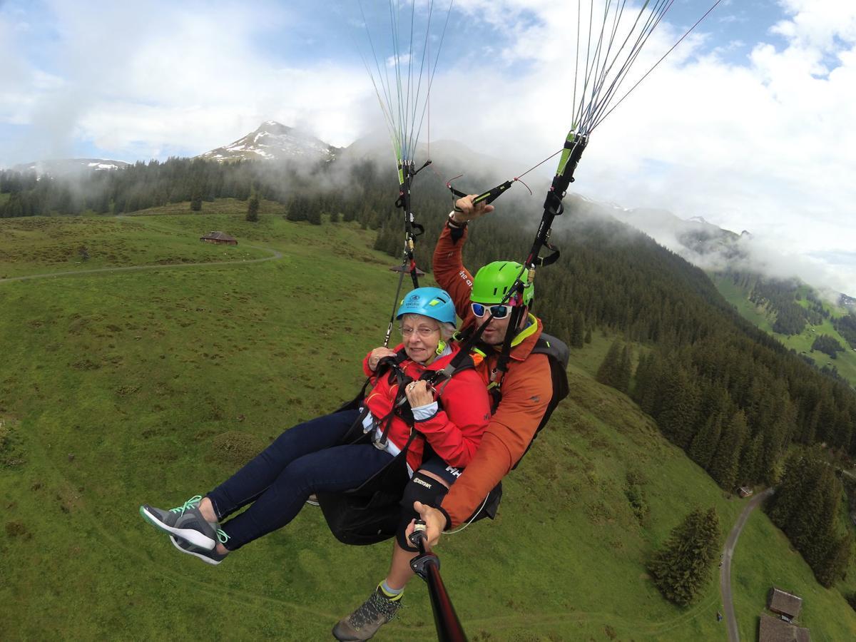 Doris Heyman paragliding through the Swiss Alps