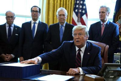 trumps signs CARES Act