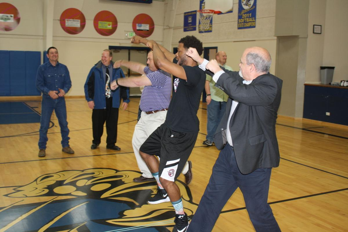 Steve Callaway and Mike Mooney dance with Harlem Ambassadors