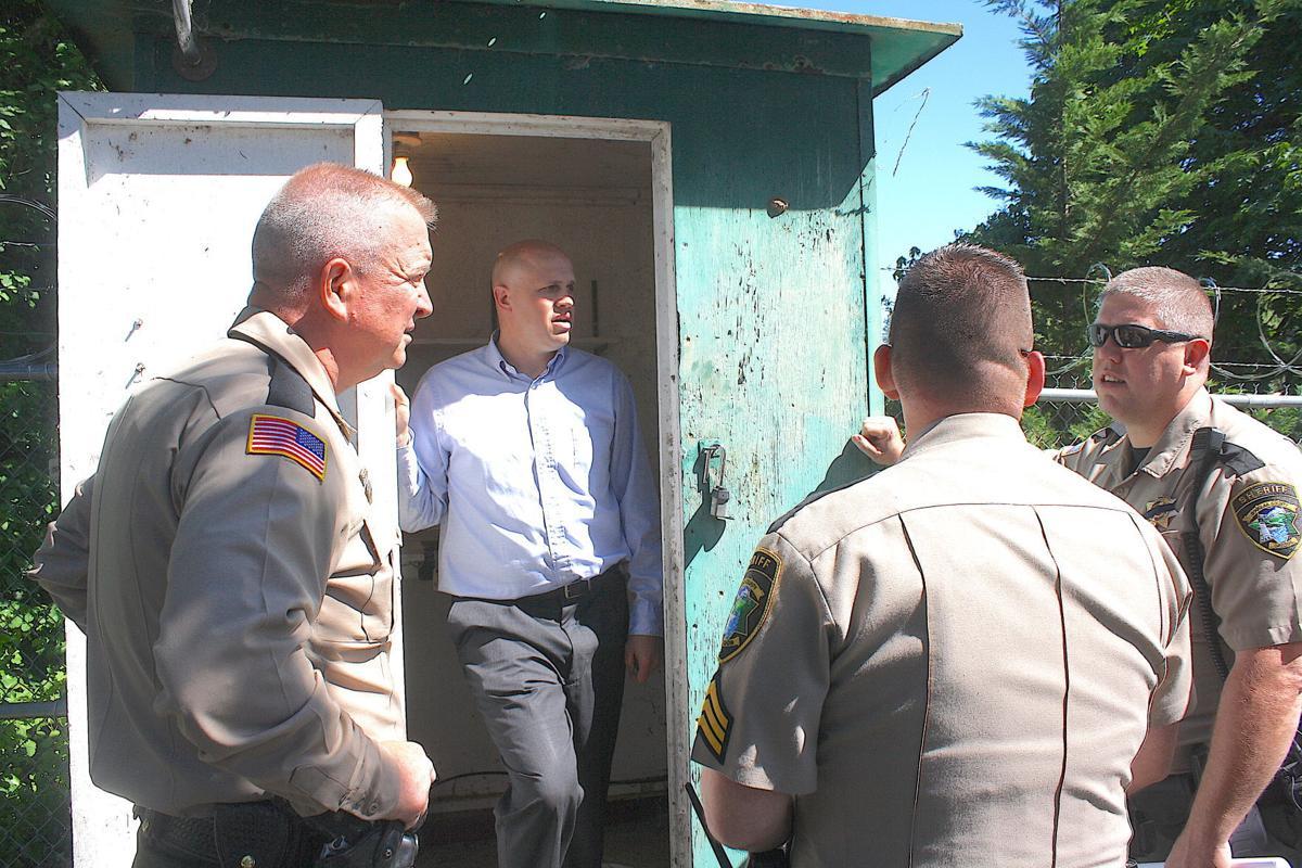 Sheriff John Hanlin and deputies chat about water temperature sensor
