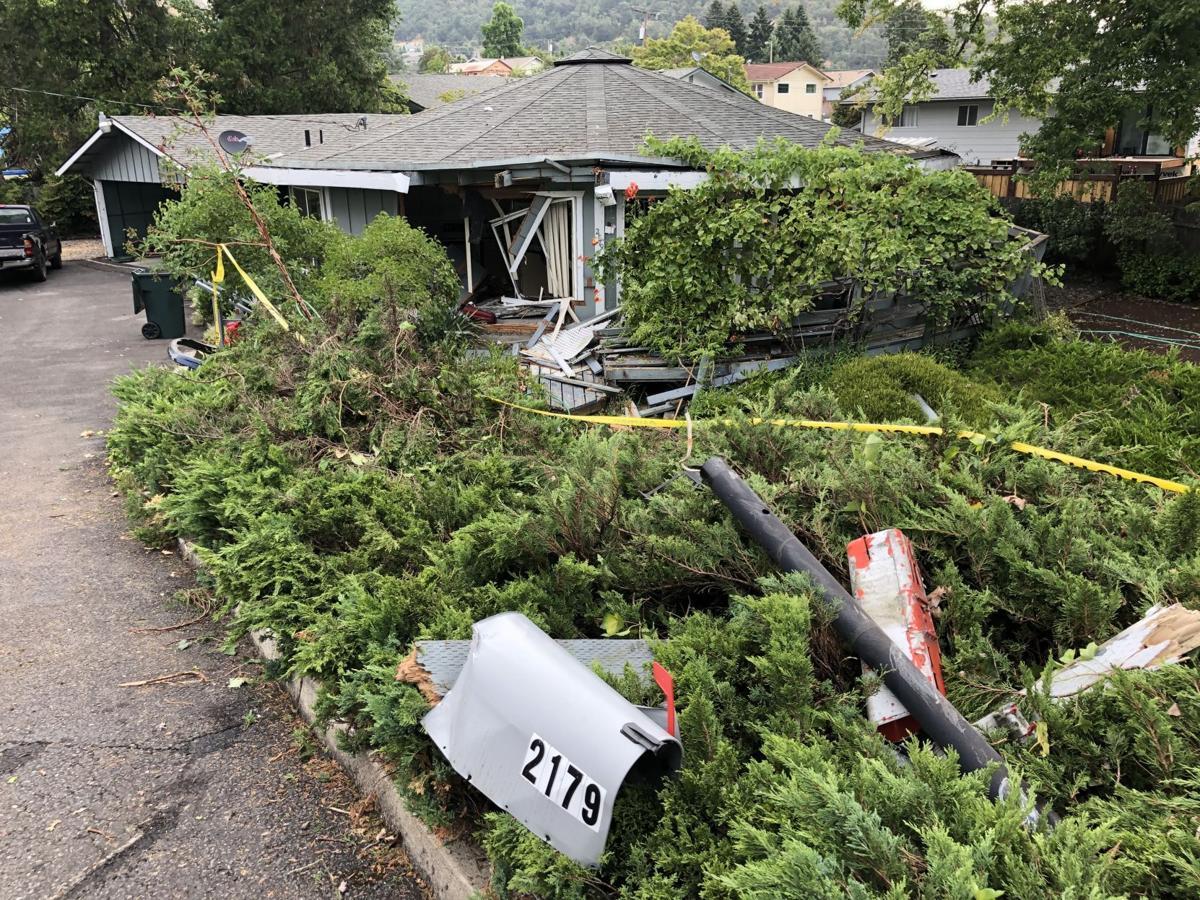Crash damages home on N.W. Troost Street in Roseburg  Monday morning.