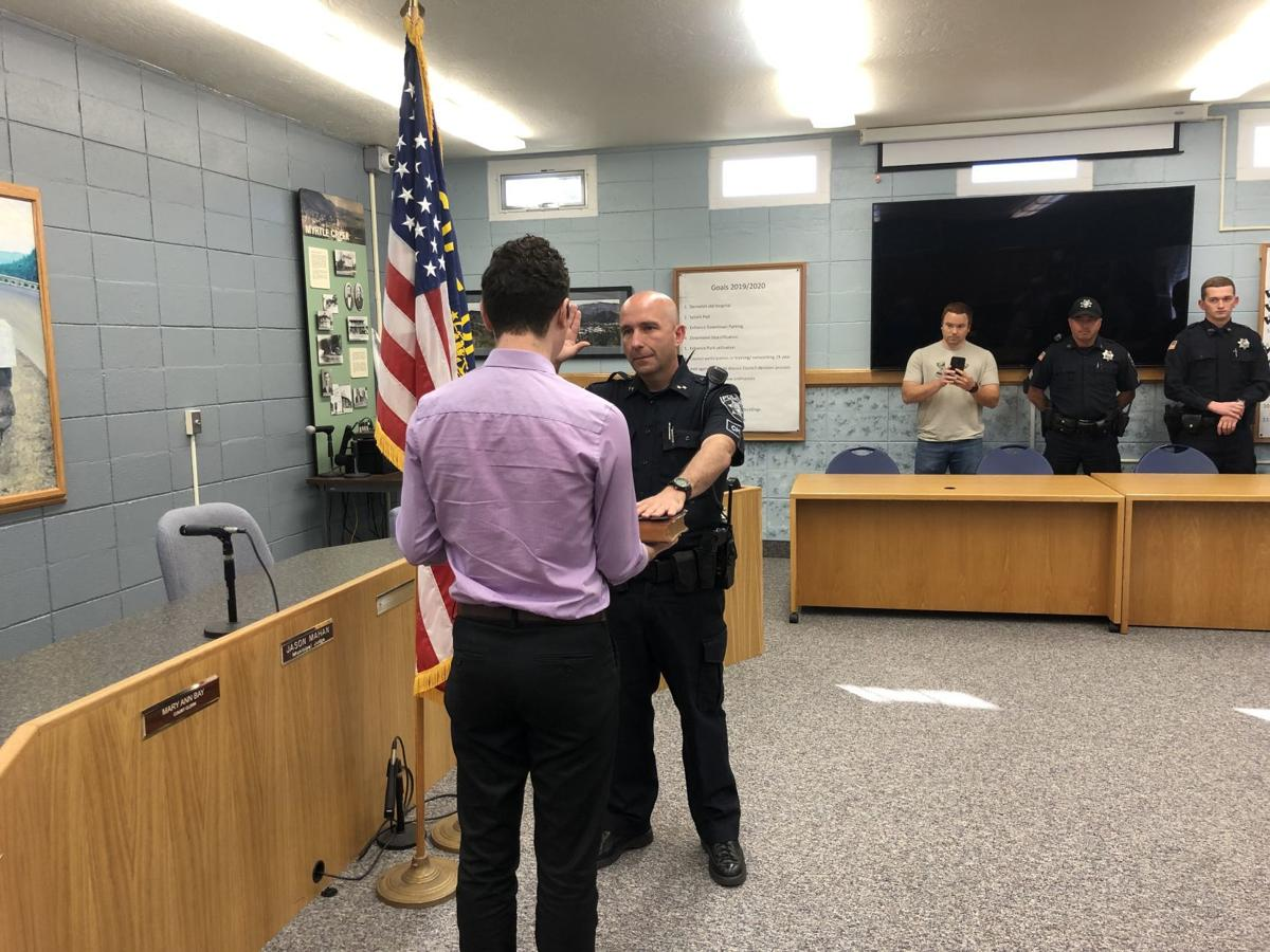 Jonathan Brewster is sworn in as Myrtle Creek Police Chief