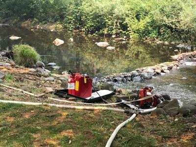 Pumps using creek to fill up a hose lay.