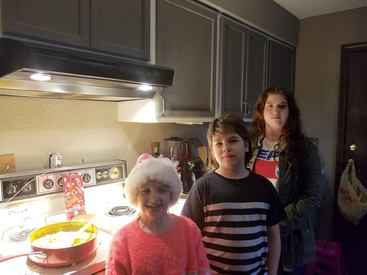 Akira Cooper with her brother and sister at their home in Winston