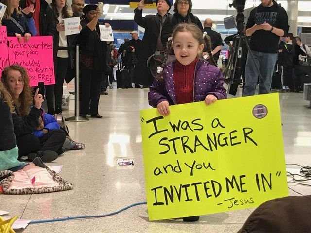 Hundreds protest Trump's executive order at Indy airport tonight