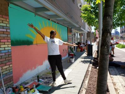 Black artists are painting murals on boarded-up windows of downtown businesses
