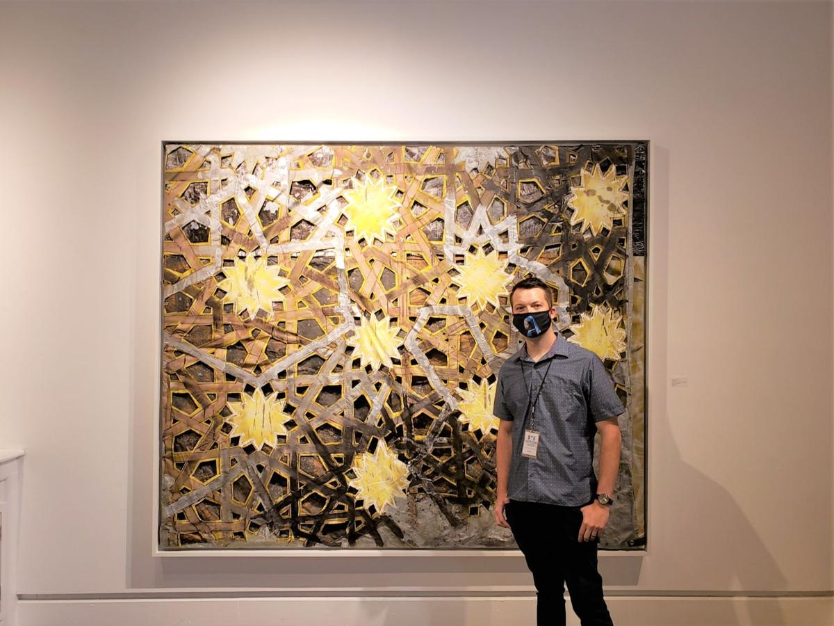 """Willard Johnson in front of his painting """"The Tide"""""""