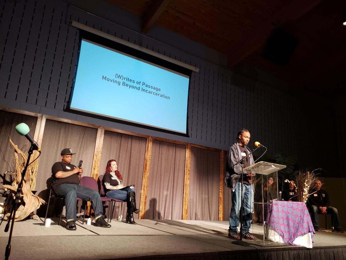 Phil Roberts at podium during (W)rites of Passage event at the Church Within