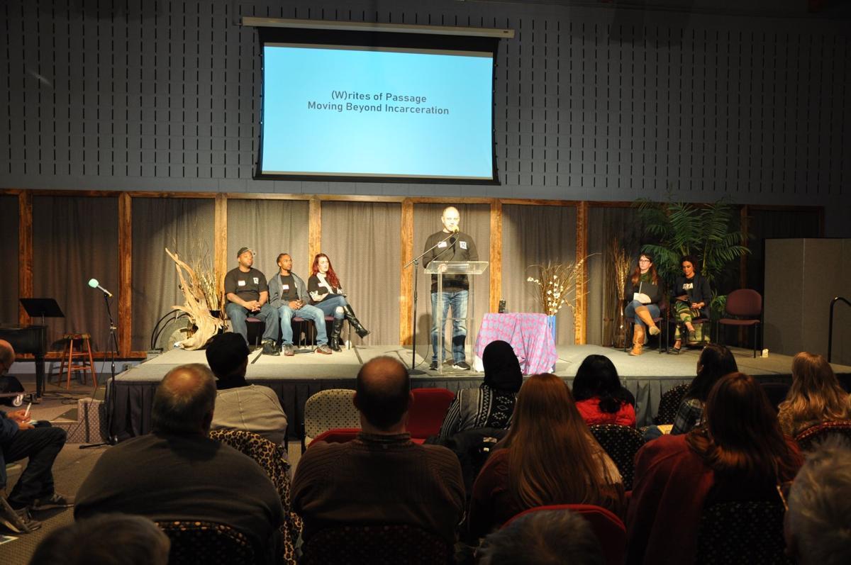 Emcee David Gaspar at podium during (W)rites of Passage