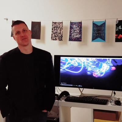 Matt McClure in front of virtual reality console in Artlink.