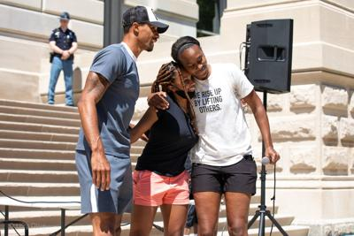 Former Pacer George Hill (L) and former Indiana Fever player Tamika Catchings (R) with friend