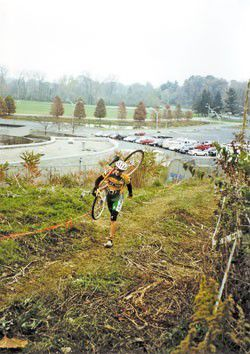 """""""Cyclocross riders jump on, off their bikes"""""""