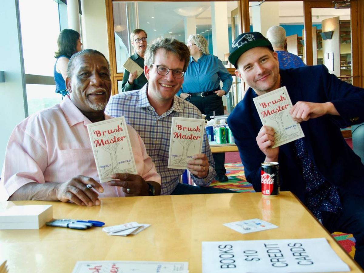 L to R: the Brush Master (aka Jasper Travis), John Green, and Kyle Long at Central Library book release party