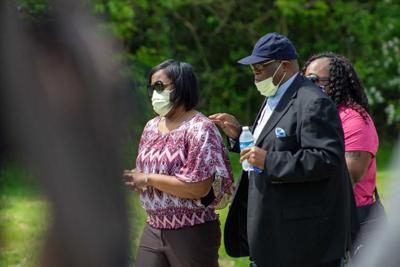 Dreasjon Reed's mother, Demtree Wynn, walks with Elder Lionel Rush of Greater Anointing Fellowship Church before a press conference June 2 near Michigan Road and 62nd Street