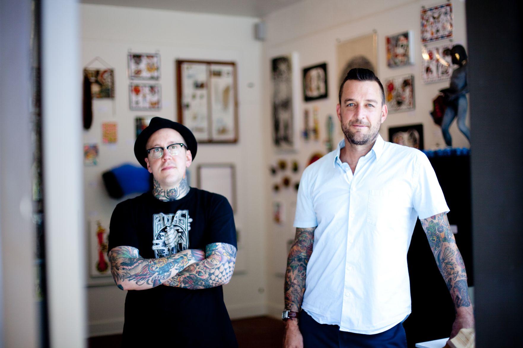 Two boyz with great tattoos pound