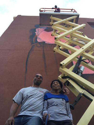 A Mari Evans mural appears on Mass Ave