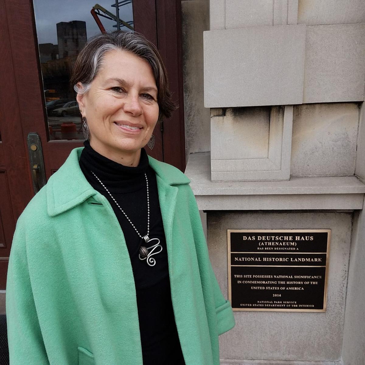 Cassie Stockamp in front of National Landmark marker at Athenaeum entrance