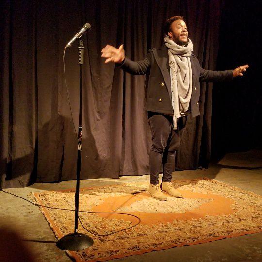 Devon Ginn reciting a poem