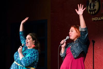 Gwen Sunkel in blue dress, Erin Carr in red dress