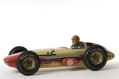 Isolated shot of vintage toy racing car on white background