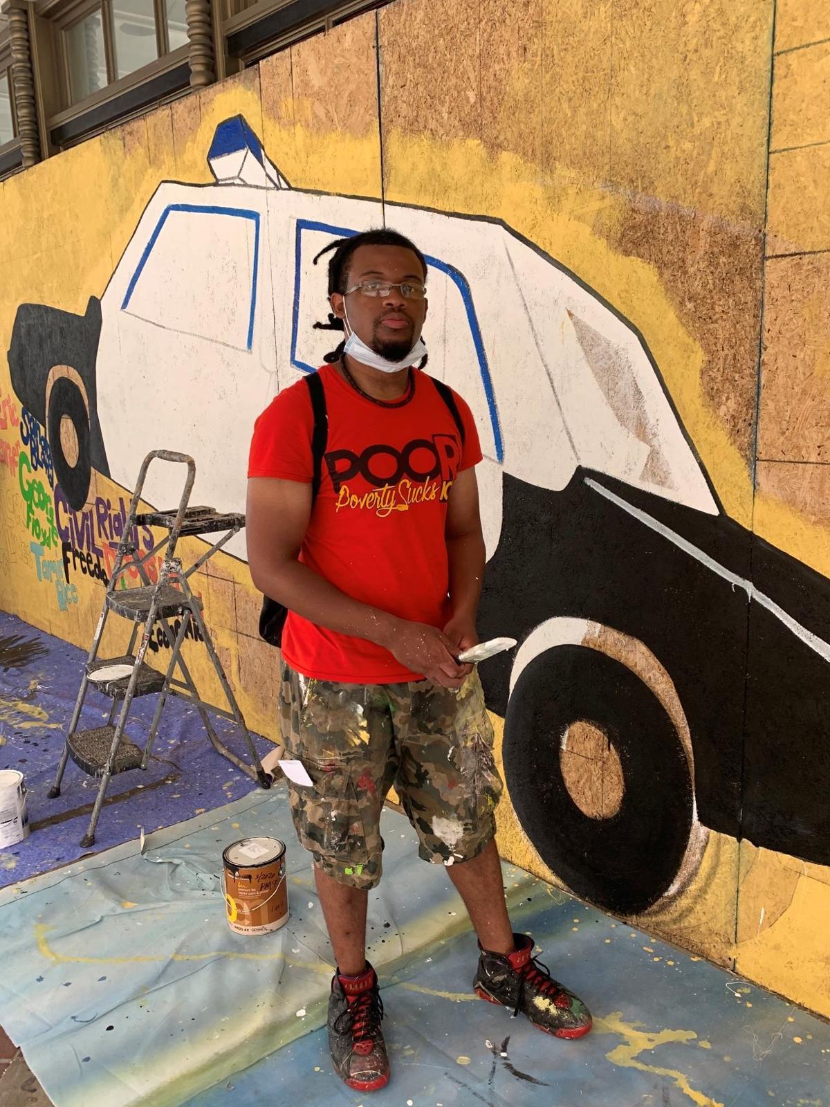Mechi Shakur with his mural