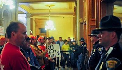 Statehouse stalls as Dems stage walkout