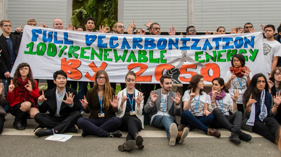 US youth actions in Paris call for clean energy, phase out fossil fuels