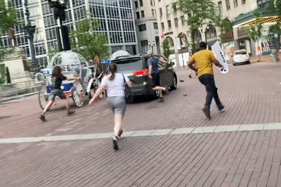 Person drives through protest crowd on Monument Circle