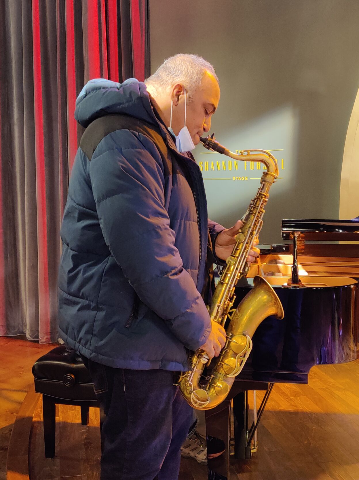 """Rob Dixon on sax during rehearsal for """"The Voodoo of Hell's Half-Acre"""""""