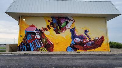 "Checking out Dan Thompson's ""Eye 2 Eye"" mural on Shadeland Avenue"