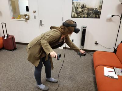 Elizabeth Thill, Director of the Program in Classical studies in World Languages and Cultures at IUPUI, assembling the Great Marble Map of Rome in virtual reality.