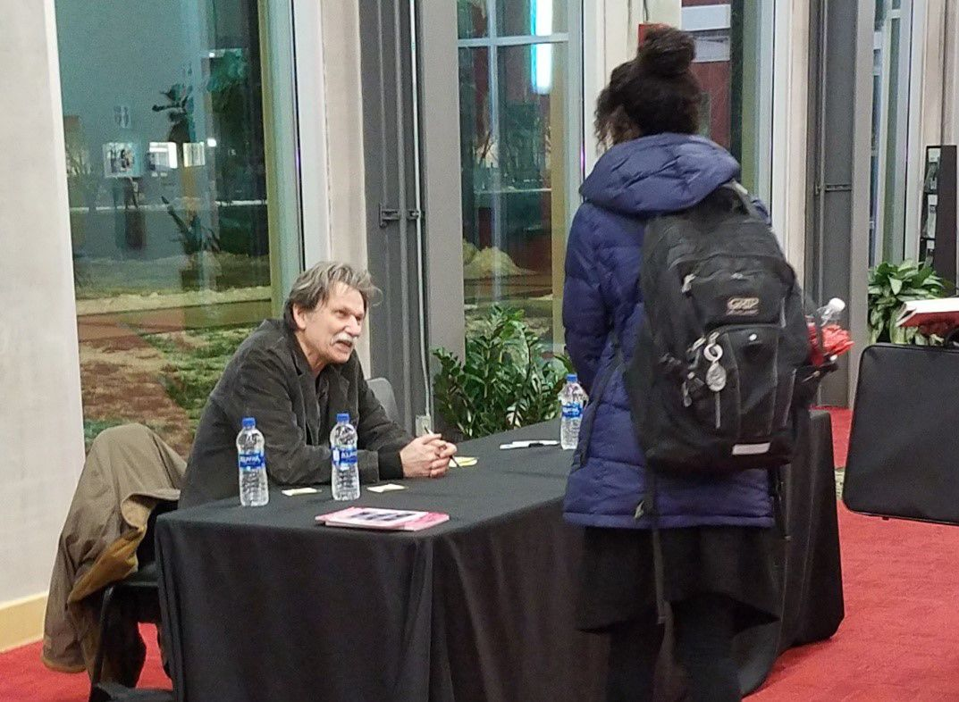Gregory Orr signing books at the Schrott Center for the Arts