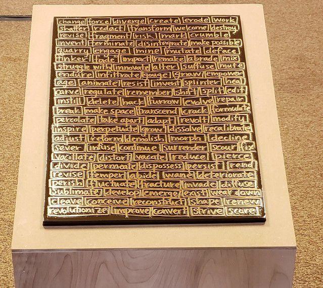 Bronze plaque by Nina Elder
