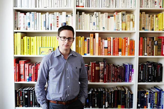 Nate Silver with his library