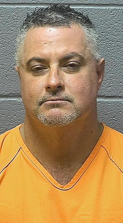 Man held on drug, weapons charge