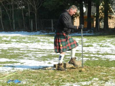In muddy conditions, athletes compete at Kernstown Highland Games