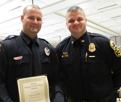 Police academy graduates 13