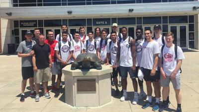 Woodstock connection leads Australian hoops team to MMA visit