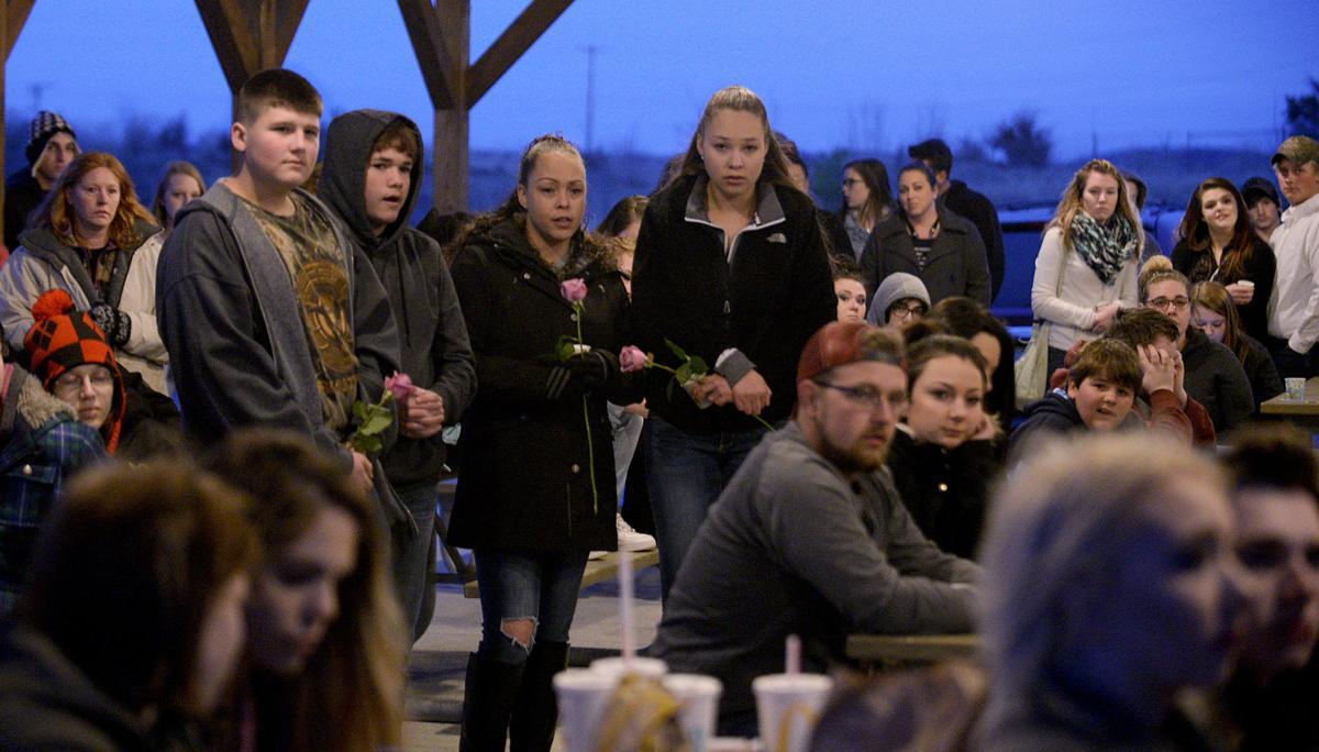 Friends, family hold vigil for slain woman